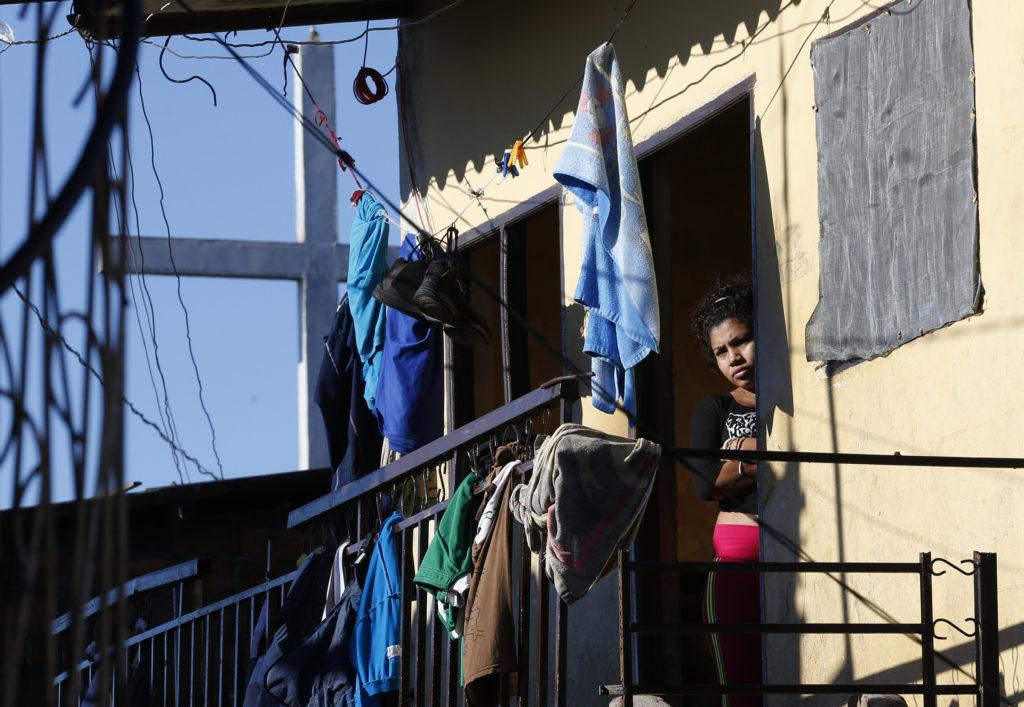 A woman in Palmasola prison in Santa Cruz, Bolivia, awaits Pope Francis' arrival July 10. (CNS photo/Paul Haring)